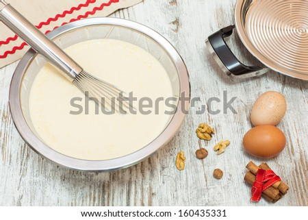 Ingredients for making pancake  batter. Batter making ingredients ready for making pancakes, on  wooden table. Viewed from above - stock photo