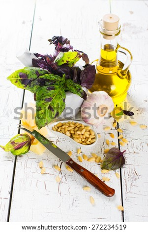 Ingredients for making pesto sauce on white wooden table, selective focus - stock photo