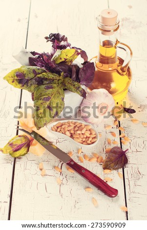Ingredients for making pesto sauce on white wooden table, selective focus. Toned image - stock photo