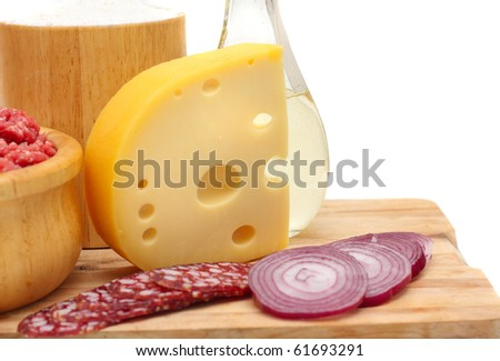 Ingredients for making pizza with cheese and sausage on a white background. - stock photo