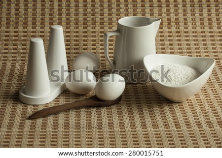 Ingredients for pancakes isolated on table mat - stock photo