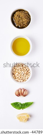 ingredients for pesto over white background. top view