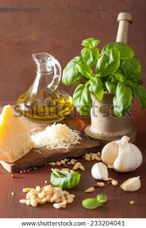 ingredients for pesto sauce over wooden rustic background - stock photo