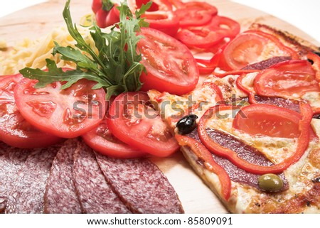 Ingredients for pizza. Tomato, cheese, paprica and salami - stock photo
