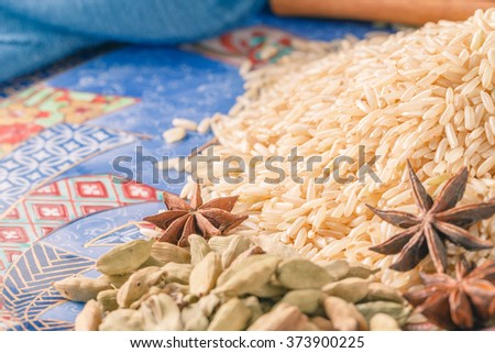 Ingredients for preparation rice, closeup on ceramic bowl background - stock photo
