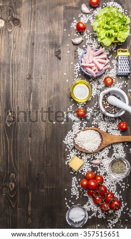 ingredients for risotto, ham, vegetables, seasonings on wooden rustic background top view close up - stock photo