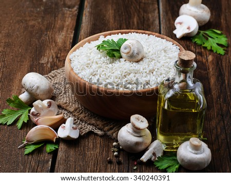 Ingredients for risotto: rice, mushroom, garlic, oil. Selective focus - stock photo