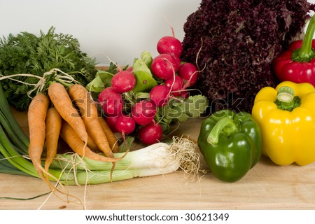 Ingredients for salad on chopping board - stock photo