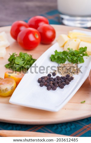 Ingredients for scramble egg on wood table.