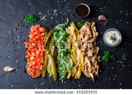 Ingredients for Shawama sandwich with spices and sauces on dark background. Selective focus. Horizontal Top view - stock photo