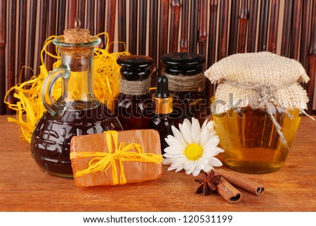 ingredients for soap making on brown background - stock photo