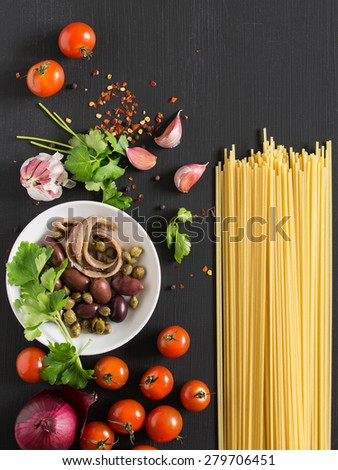 Ingredients for Spaghetti alla Puttanesca. - stock photo