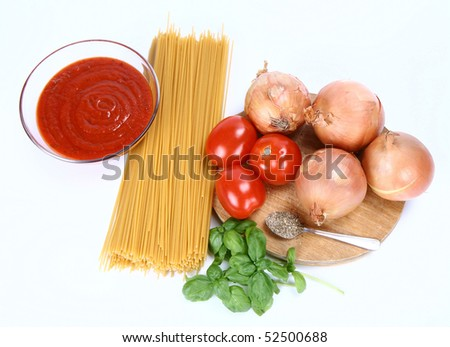 Ingredients for spaghetti bolognese or napoli on white background - stock photo