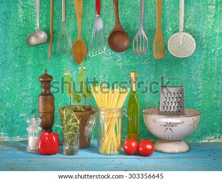 ingredients for spaghetti dish, and kitchen utensils - stock photo
