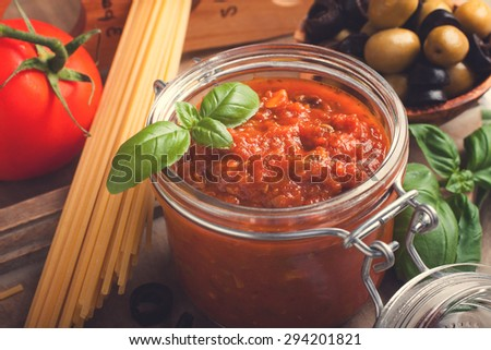 Ingredients for spaghetti with tomato sauce on wooden background. Italian healthy food background. Retro style toned. - stock photo