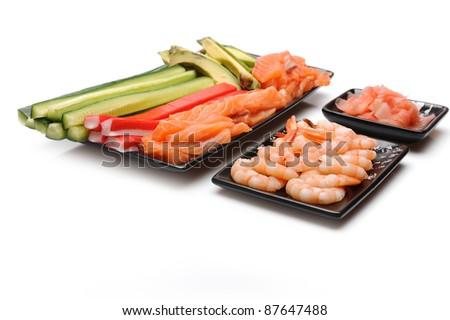 ingredients for sushi making. salmon, cucumber, avocado, shrimps, ginger, crab sticks. isolated - stock photo