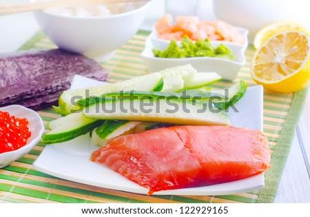 ingredients for sushi, sakmon and cucumber - stock photo