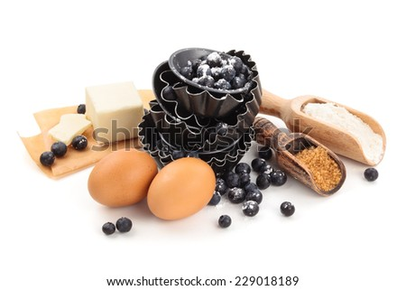 Ingredients for tarts with blueberries. Isolated on white. - stock photo