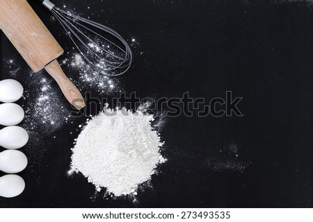 Ingredients for the dough on a black background