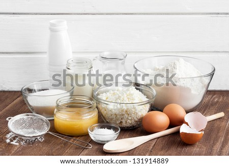Ingredients for the dough on the wooden table