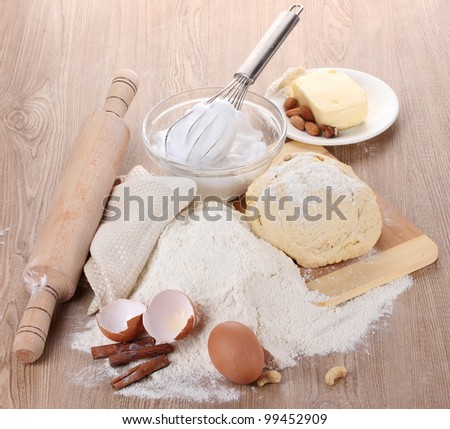 Ingredients for the dough wooden table - stock photo