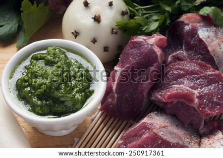 ingredients for the preparation of meat broth with veal and different vegetables - stock photo