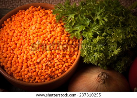 Ingredients for Turkey vegetable soup with red lentils, lying on an old wooden board and sacking.  - stock photo