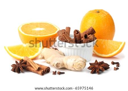 Ingredients for winter hot drink. Orange with cinnamon, ginger, anise and clove isolated on white background - stock photo