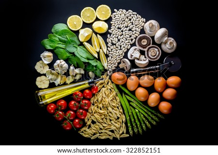 Ingredients nicely laid at black background - stock photo