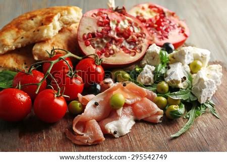 Ingredients of Mediterranean cuisine, on wooden board background - stock photo