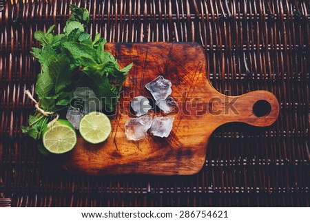 ingredients of summer cocktail mojito on the wooden desk - stock photo