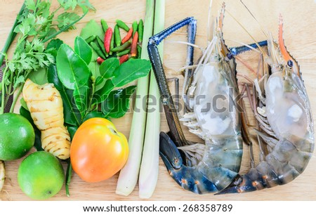 Ingredients of Tom Yam Kung , big shrimp ,lemon, lemon grass,tomato and lime for favourite spicy thai cuisine food with herb - stock photo