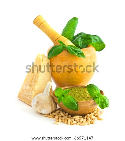 Ingredients to make basil pesto sauce isolated on white background - stock photo