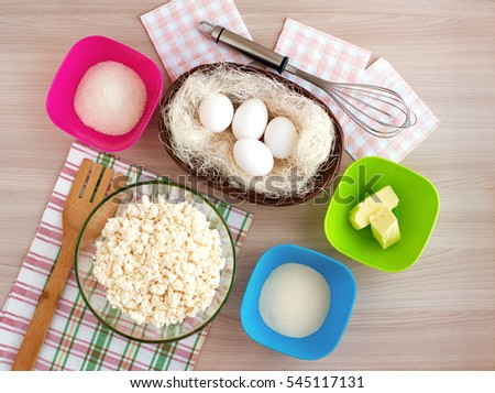 Ingredients top view. Eggs, cottage cheese, semolina, sugar and butter needed for cooking curd pancake. The recipe of curd casseroles included dietary products. Eggs can be used for Easter.