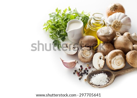 Ingredients with fresh mushrooms on a white background. - stock photo