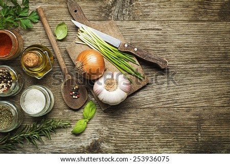 Ingredients with Spices on old wooden background overhead close up shoot - stock photo