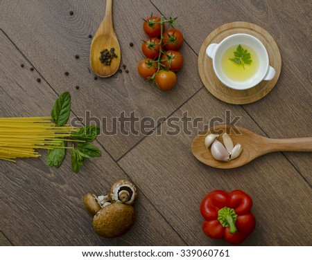 ingridients for a pasta with tomatoes and peppers - stock photo