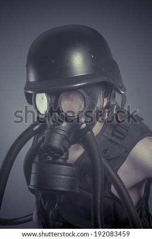 Inhalation, Man with black gas mask, pollution concept and ecological disaster
