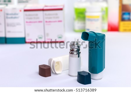 Inhaler - Asthma inhaler medicine for treating shortness of breath and wheezing. Chronic disease control, allergy induced asthma remedy and chronic pulmonary disease concept. selective focus