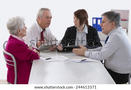 inheritance counselor meeting with Senior woman about her last will - stock photo