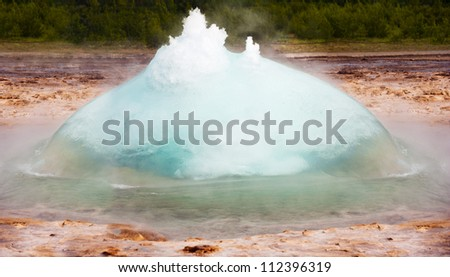 Initial phase of an eruption of Strokkur, famous Icelandic geyser - stock photo