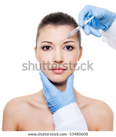 Injection in the eyebrow on female face - isolated on white - stock photo