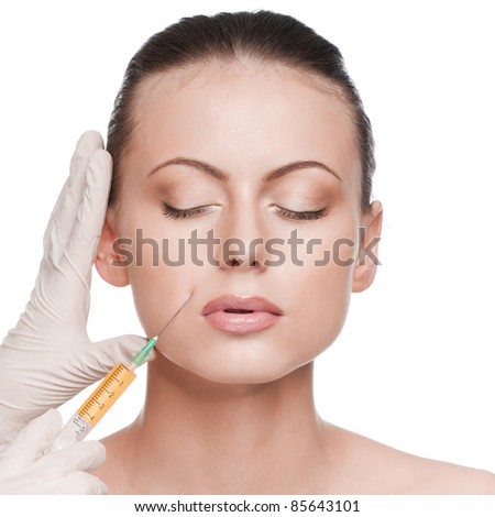 Injection in the female face. Lips zone. Isolated - stock photo
