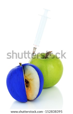 Injection into apple isolated on white - stock photo