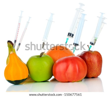 Injection into fruit and vegetables isolated on white - stock photo
