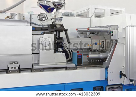 Injection Molding Machine for Plastic Parts Production - stock photo
