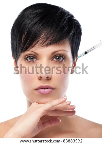 injection of botox on female forehead - female portrait,studio shot, retouched with special care.Plastic surgery concept - stock photo