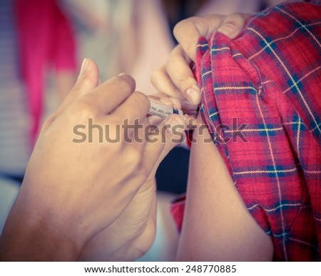 Injection vaccinate protection vintage style color. - stock photo