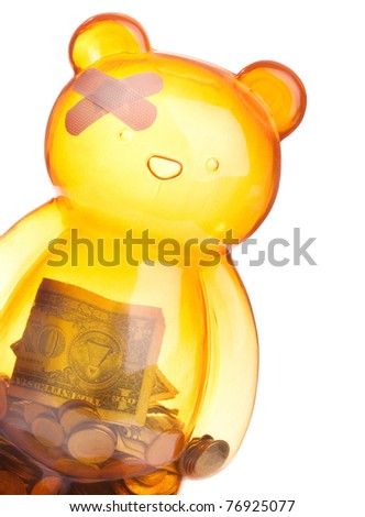 Injured bear  or piggy bank isolated on white depicting financial crisis, regression, economic trouble and more - stock photo