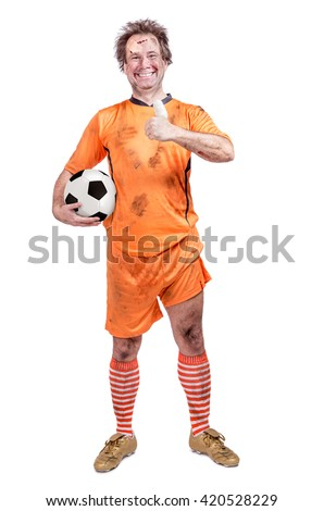 injured football player shows a symbol of success. Soccer player holding the ball and gesturing success with thumb up. - stock photo